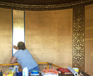 Avani team artist applying ornate gold finish to rotunda
